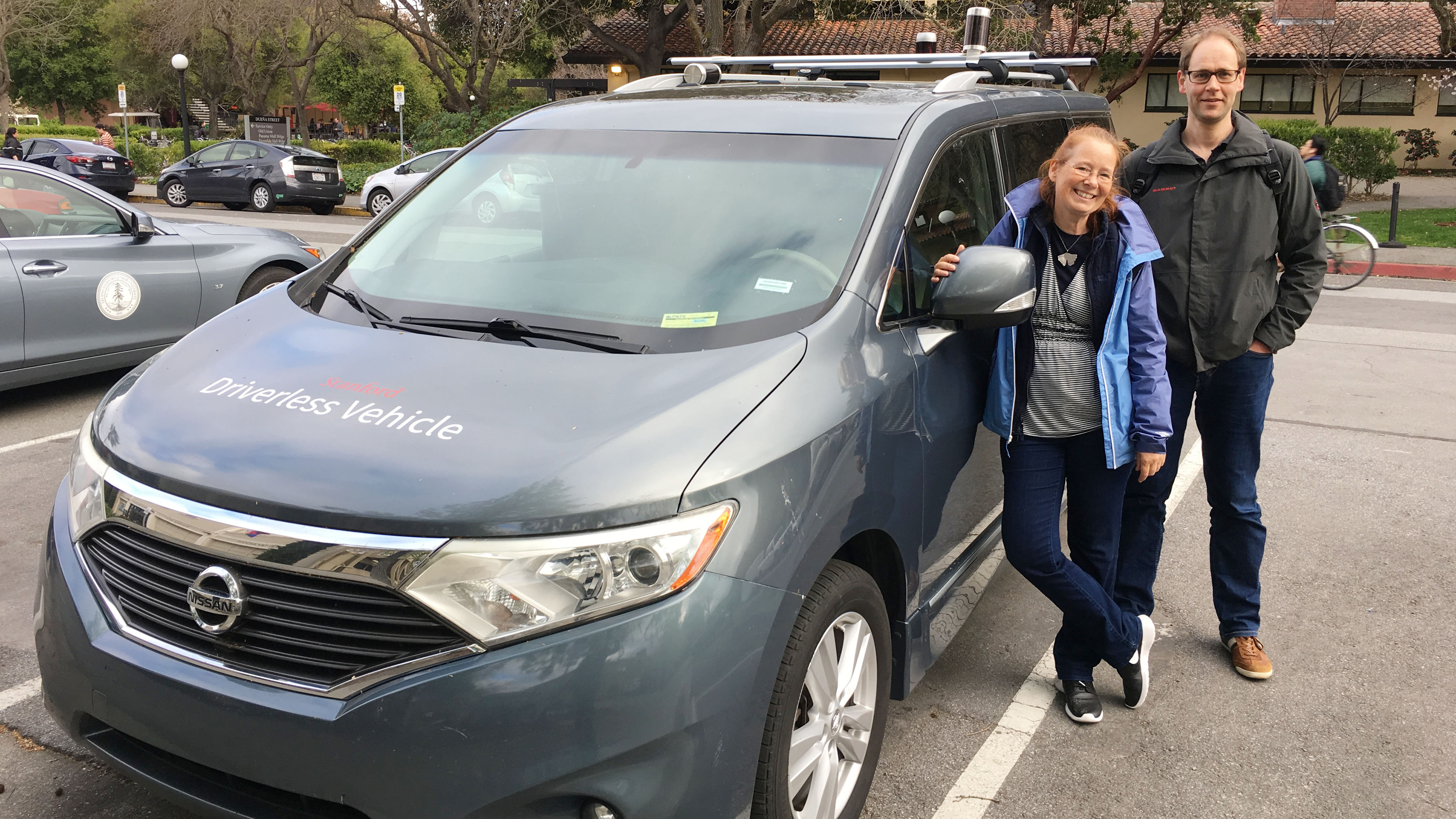 Kerstin Fischer and Kristian Mortensen with one of the 'Stanford Autonomous Cars' on Stanford Campus