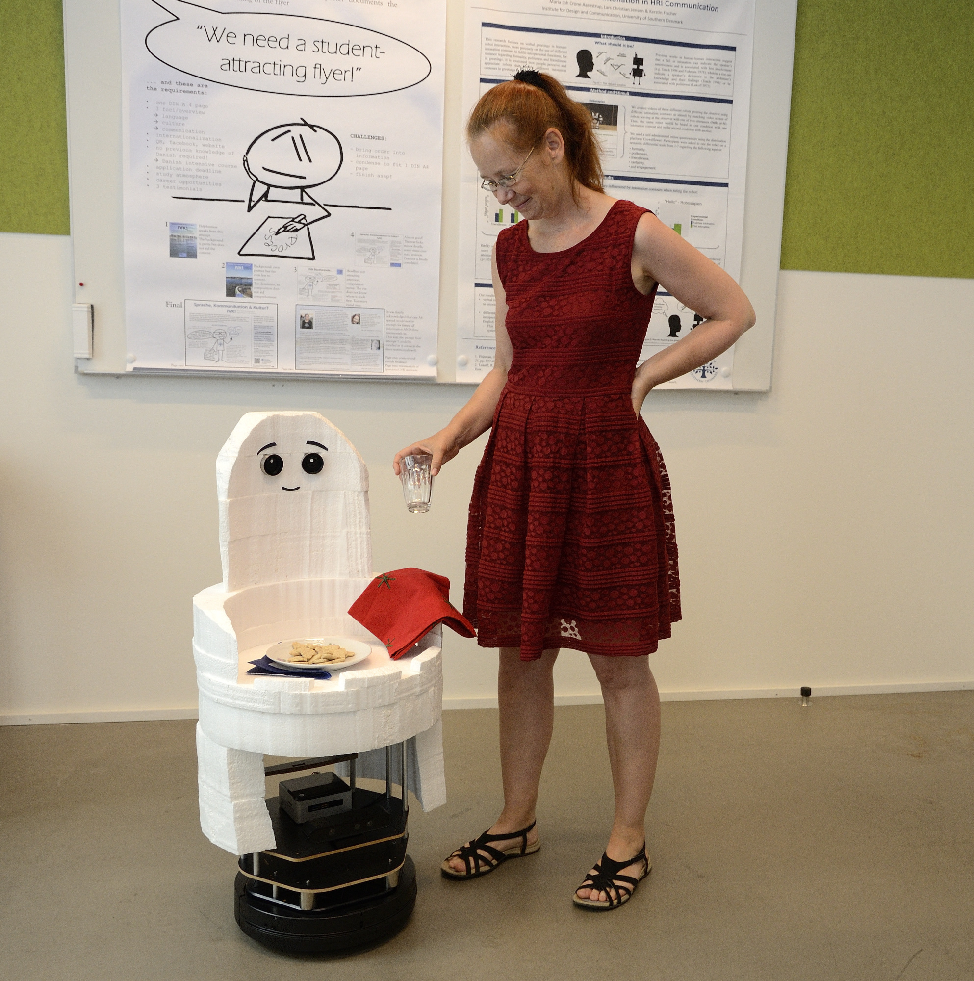 Kerstin Fischer experimenting with Casper robot for SMOOTH project.