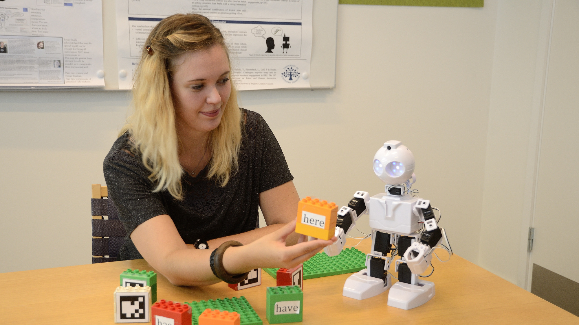 Rosalyn Melissa Langedijk experimenting with an EZ-Bot in the Lab.