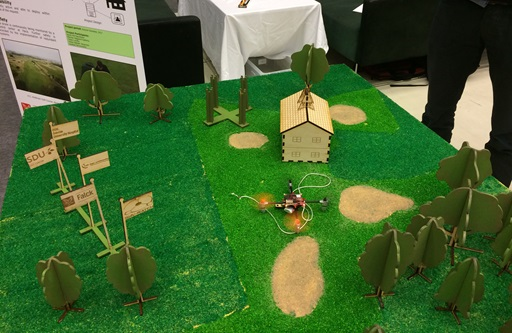 Student model of defibrillator drone on golf course