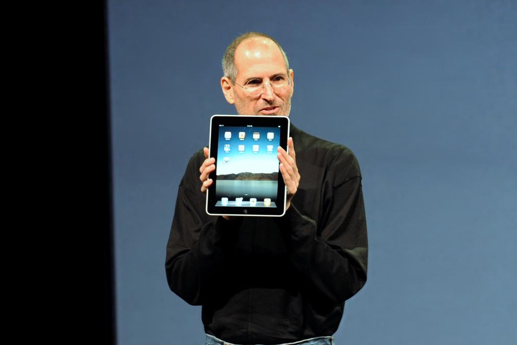 Steve Jobs presenting an iPad.