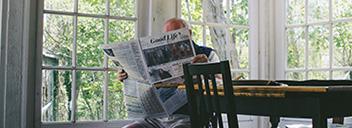 Reading elderly man